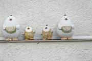 Four-part chicken-shaped colored pottery on the house wall - Chicken family