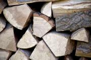 Closeup of a heap of firewood - Detail of a woodpile