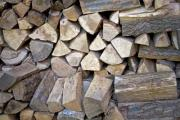 Closeup shot of a heap of firewood - Detail of a woodpile