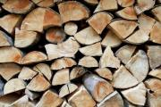 Closeup shot of a heap of firewood - Detail of a woodpile