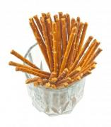 A handful of salty sticks in a glass isolated on white background - Pretzel sticks