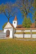 Old white church surrounded by walls in autumn - Fortified church