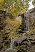 Closeup of a nice, cascading waterfall in a forest - Autumn waterfall