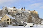 View of a castle of a city in winter time - Winter castle