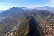 Aerial photo of a mountain range at Brasov, Romania - View of a mountain