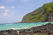 Windy weather on the volcanic island - Rocks, waves, tropical forest