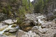 A small rapid river among big rocky mountains - Rocky river