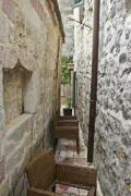 Rock walls and broken chair - Narrow alley