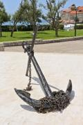 An old black anchor in a luxury resort - Black anchor