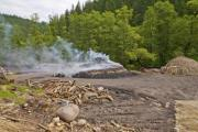 A charcoal pile during combustion - Smoking charcoal pile