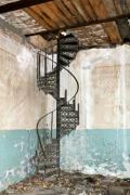 Iron staircase in a ruined, abandoned house - Stairway to nowhere