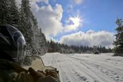 Picturesque view from a snowmobile - On snowy road