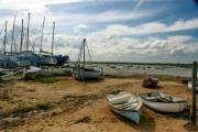 Boats grounded in the low waters of Mersea Island. - Mersea Island, Colchester, United Kingdom