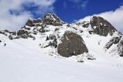 A mountain ridge with snow and big rocks - Snowy mountain ridge