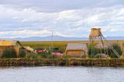 Floating island on Lake Titicaca with the Andes in the background - Floating island on lake titcaca