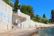 Lonely beach somewhere in Montenegro with communist frescoes - Retro beach