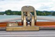 Oldtimer sailing yacht's teak wood deck, with bronze windlass - Bronze pulley