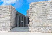 White stone wall with black barred gate - Gate of the mausoleum