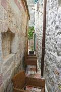 Narrow alley between two stone-built houses, somewhere in Dalamtia - Narrow alley