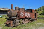Old, not used locomotive in the grass - Rusty age-old loco