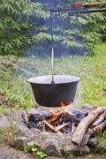 Cooking outdoors in a cauldron - Cauldron over the fire