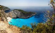 A panoramic image about this beautiful bay in Zakynthos, Greece. These are the real tones, so this bay is incredibly blue and azure! - Navagio bay - Zakynthos - panoramic image