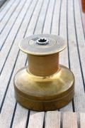 Teak deck and bronze windlass on a classic sailing yacht's deck - Bronze windlass