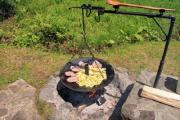 Disc grill and a big kitchen spoon - Disc grill on open fire