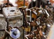 Love lock hanging on the rail. - Padlock