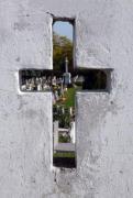 Cross in the cemetery fence. - Cross