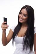 Beautiful young brunette phoning girl - Phoning girl