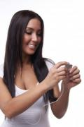 Beautiful young brunette woman with mp3 player - Girl with mp3 player