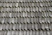 Shingle made of wood on the roof of an old house - Shingle