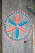 colourful carved floral pattern symbol on a log - carved wooden sign