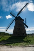 windmill in the landscape with blue sky - old windmill