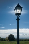 street lamp in the landscape, illuminated by the sun - street lamp