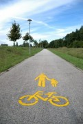 Yellow bicycle symbol on the road with sky - road symbol