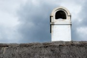 White old chimney on top of a thatched cottage - Old chimney