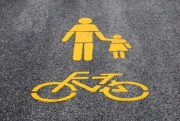 Yellow bicycle road sign painted on the asphalt - Road mark