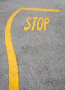Yellow stop mark on the asphalt - Stop sign