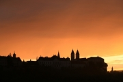 Sunset above the castle hill of a city - Sunset