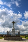 Stone cross with the crucified Jesus Christ - Stone cross