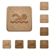 Swimming man on rounded square carved wooden button styles - Swimming man wooden buttons