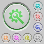 Wrench with cogwheel color icons on sunk push buttons - Wrench with cogwheel push buttons