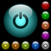 Power switch icons in color illuminated spherical glass buttons on black background. Can be used to black or dark templates - Power switch icons in color illuminated glass buttons