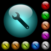 Single wrench icons in color illuminated spherical glass buttons on black background. Can be used to black or dark templates