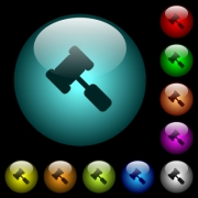 Judge hammer icons in color illuminated spherical glass buttons on black background. Can be used to black or dark templates - Judge hammer icons in color illuminated glass buttons