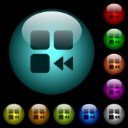 Component fast backward icons in color illuminated spherical glass buttons on black background. Can be used to black or dark templates - Component fast backward icons in color illuminated glass buttons