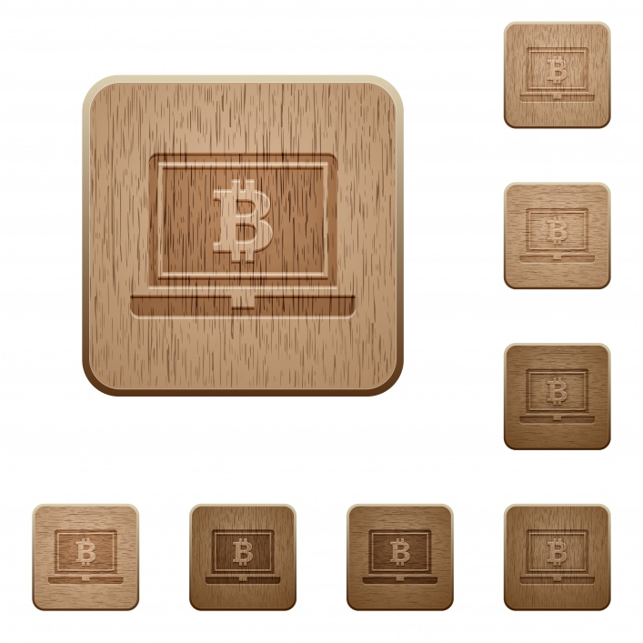 Laptop with Bitcoin sign on rounded square carved wooden button styles - Free image