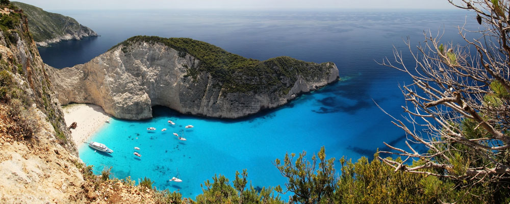 A panoramic image about this beautiful bay in Zakynthos, Greece. These are the real tones, so this bay is incredibly blue and azure!